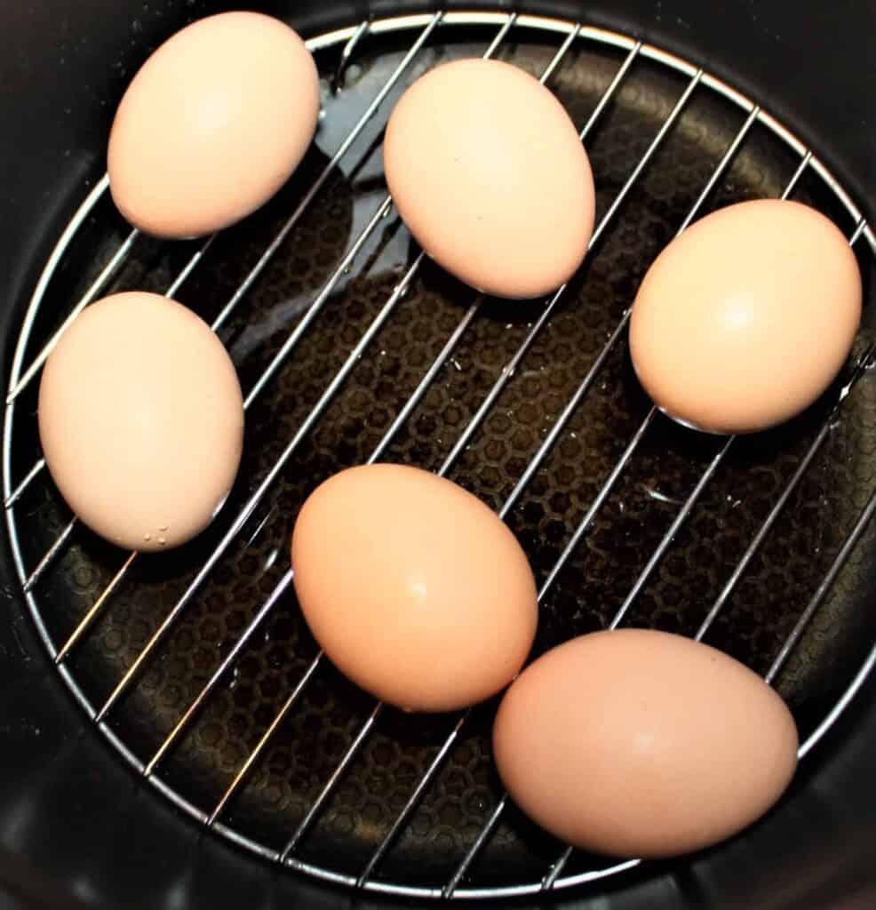 Farm fresh brown eggs on trivet in Instant Pot