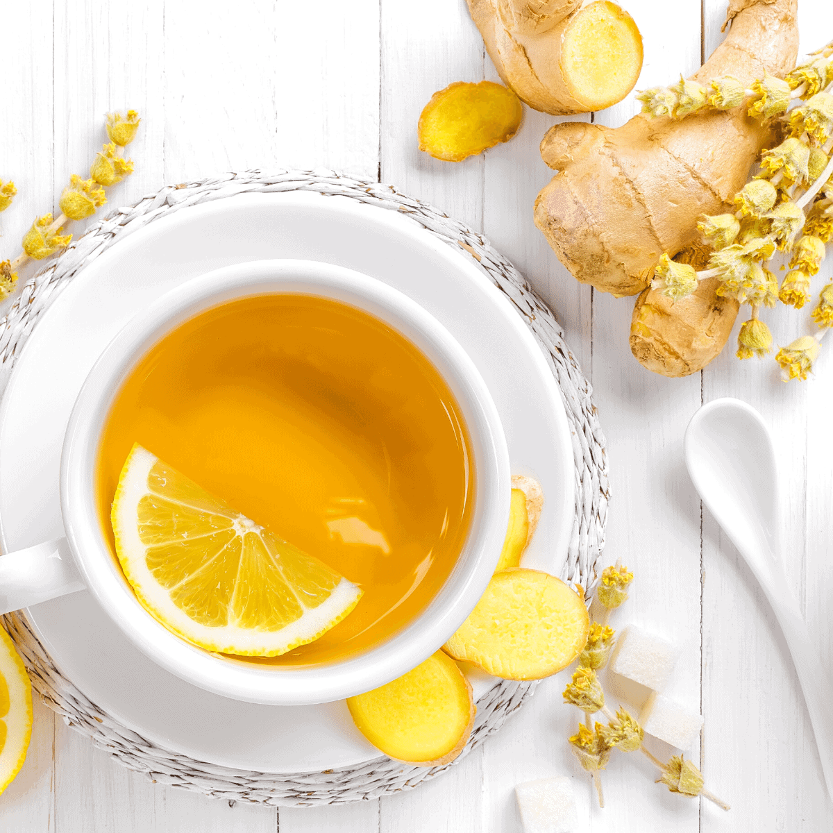 Fresh lemon ginger tea made with fresh lemons and grated ginger