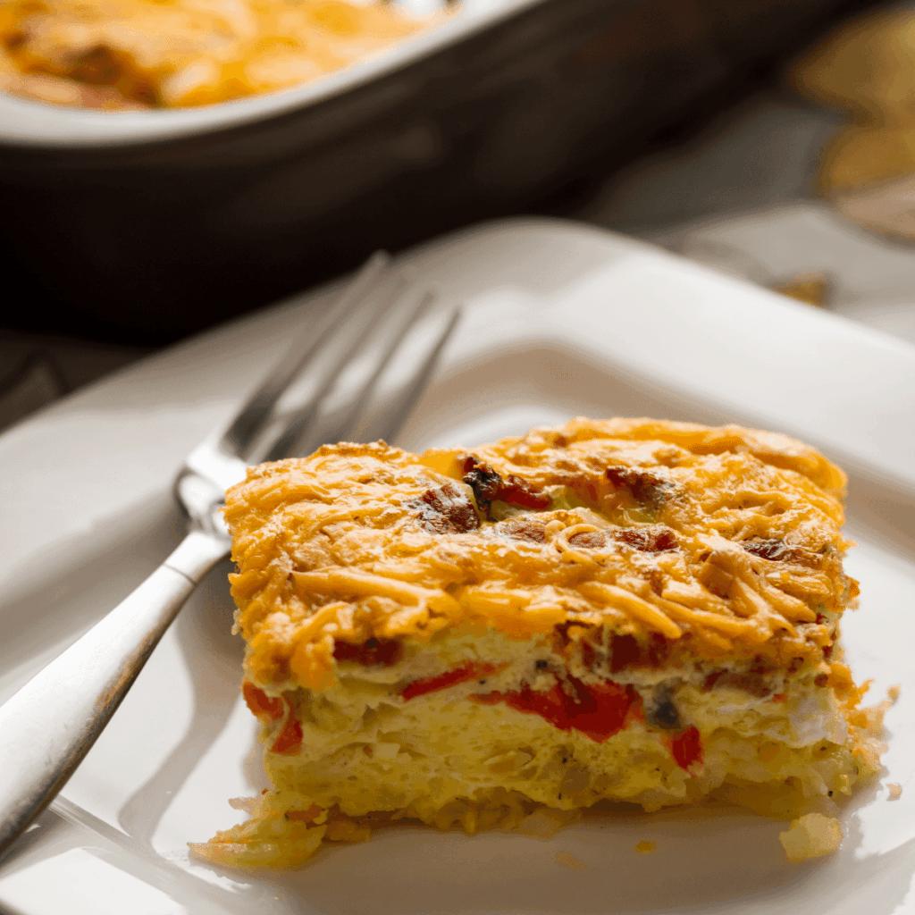 A slice of fluffy oven-baked omelet casserole