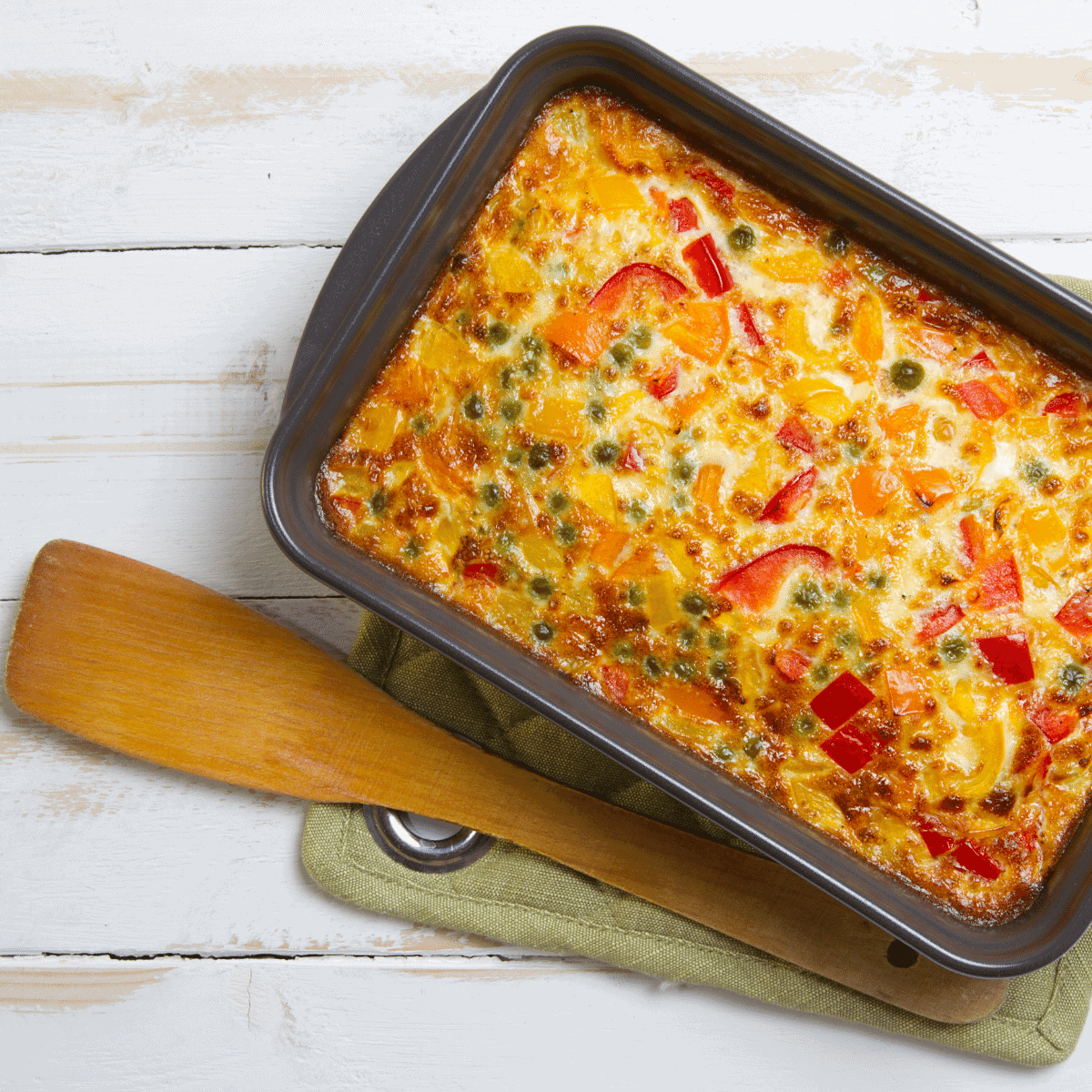 Oven baked fluffy omelet casserole made with fresh peppers, cheese, and ham