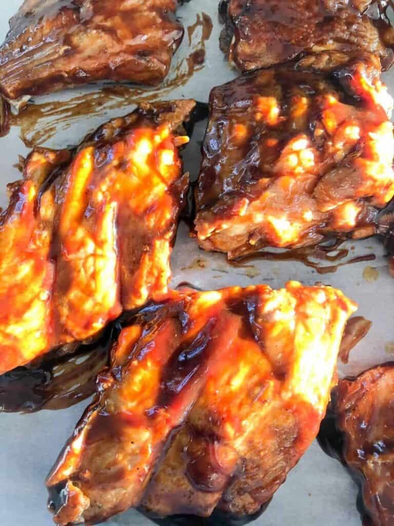 Instant pot ribs slathered in BBQ sauce and ready to be put under the broiler