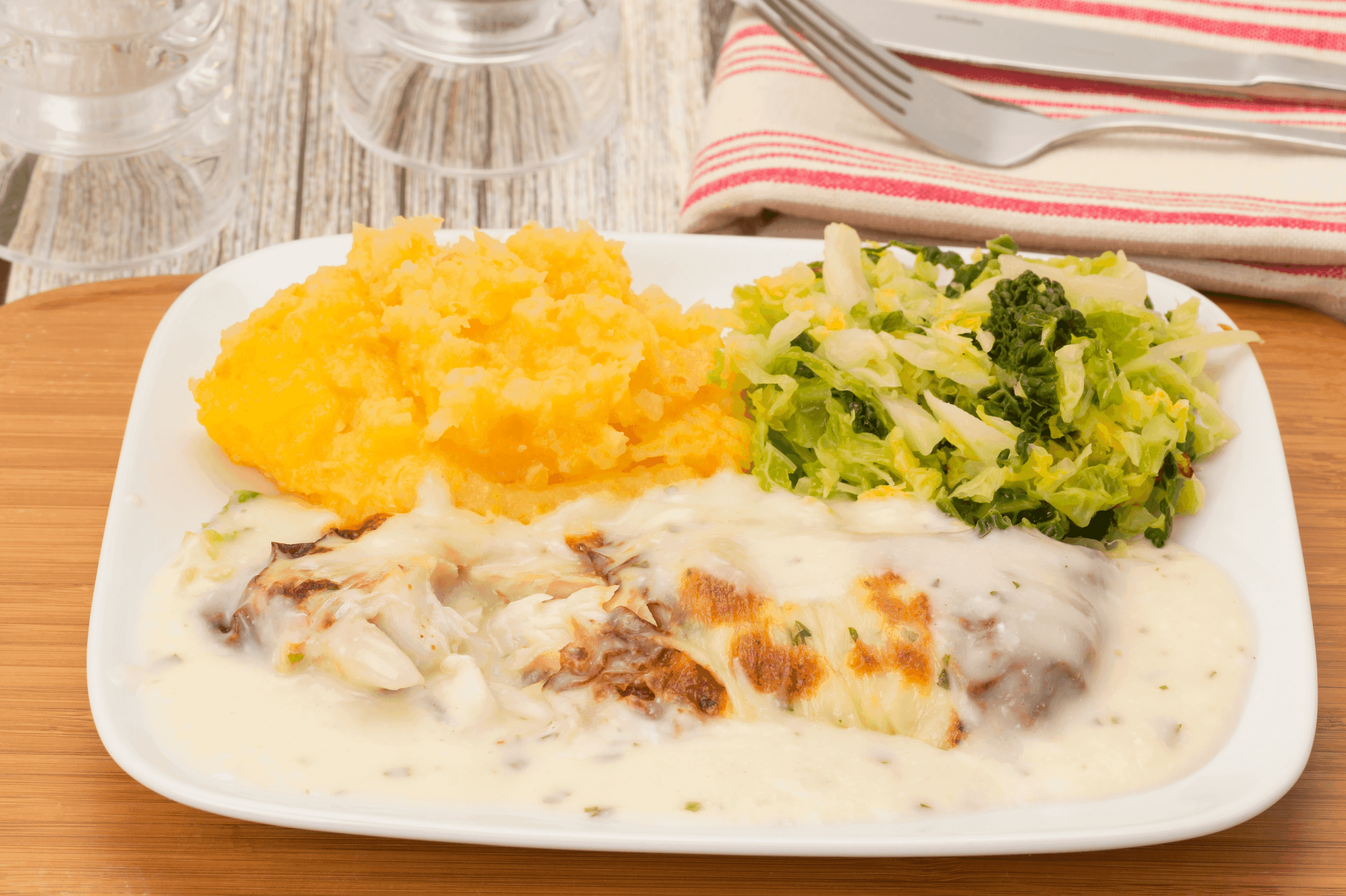 a plate of delicious baked cod served on a plate with turnip and broccoli for a healthy dinner
