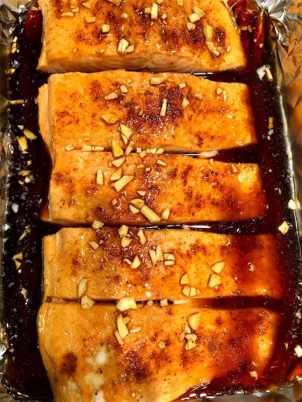 Pour the maple-soy glaze evenly over the salmon fillet