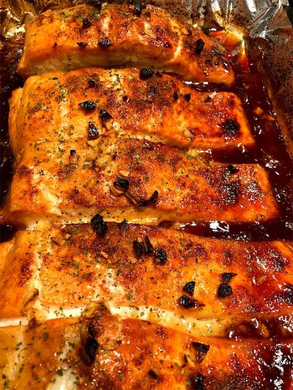 Maple-soy glazed salmon fresh out of the oven, cooked to perfection