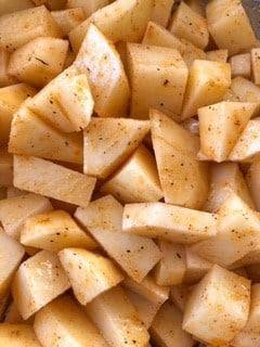 Mix together seasoning mixture with diced potatoes