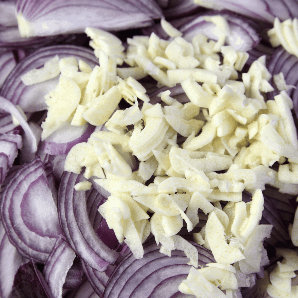 sliced red onion and garlic for the creamy chicken slow cooker soup