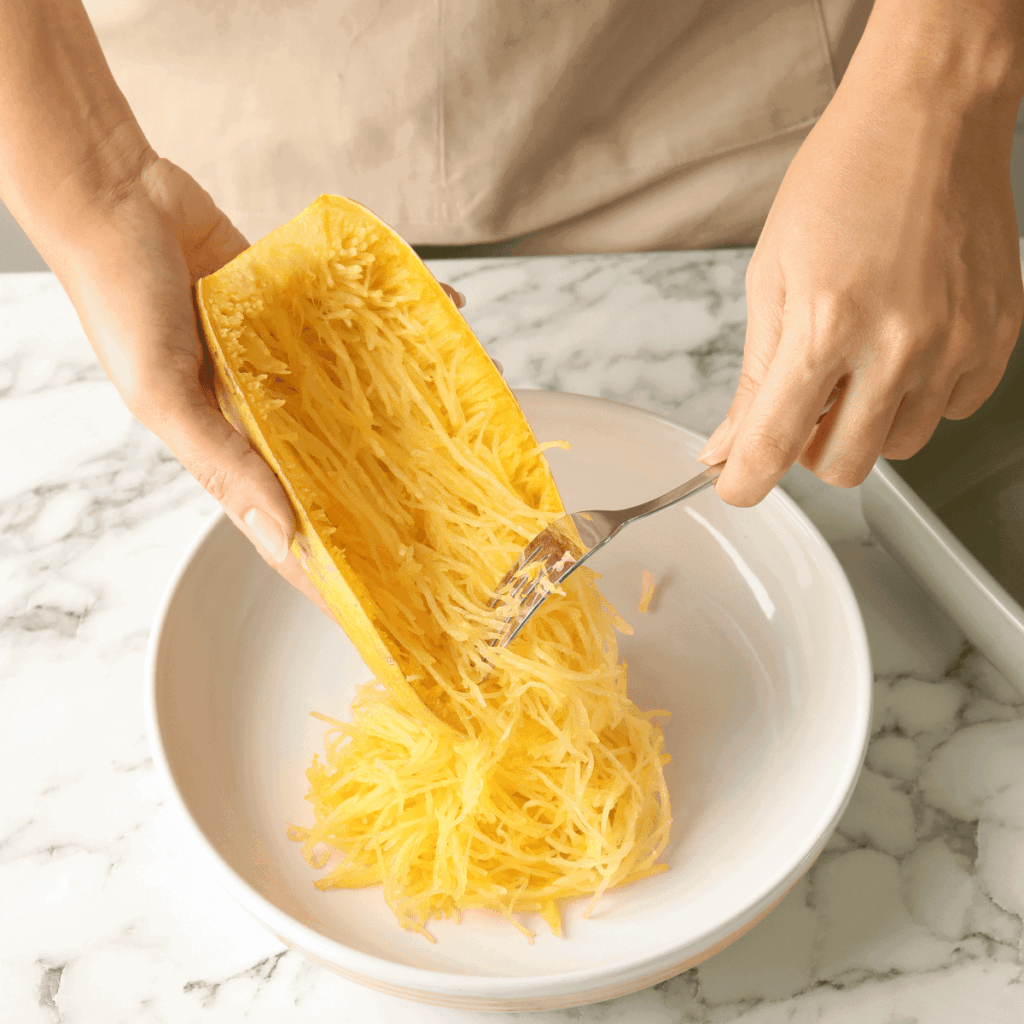 Scrape out the strings of spaghetti squash with a fork after it has cooled down