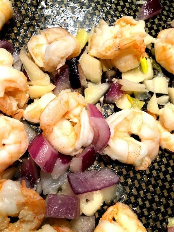 cooked shrimp and red onion and garlic