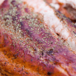 Long pin for how to make smoked salmon on a pellet grill with cooked salmon on a wood plank
