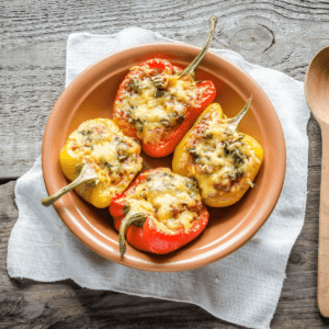 Stuffed peppers with hamburger and rice smothered in cheese in a large bowl