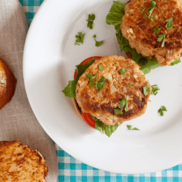 Easy to make Air Fryer tuna patties served with lettuce and tomato, garnished with parsley