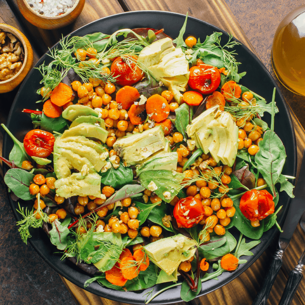 Delicious crunchy legumes served on a salad with avacado and tomato