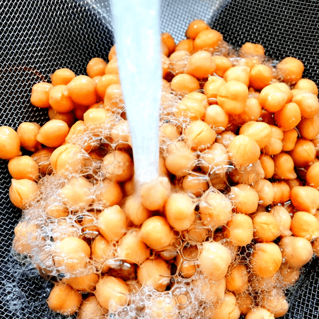Rinse chickpeas with water and drain well in a mesh strainer