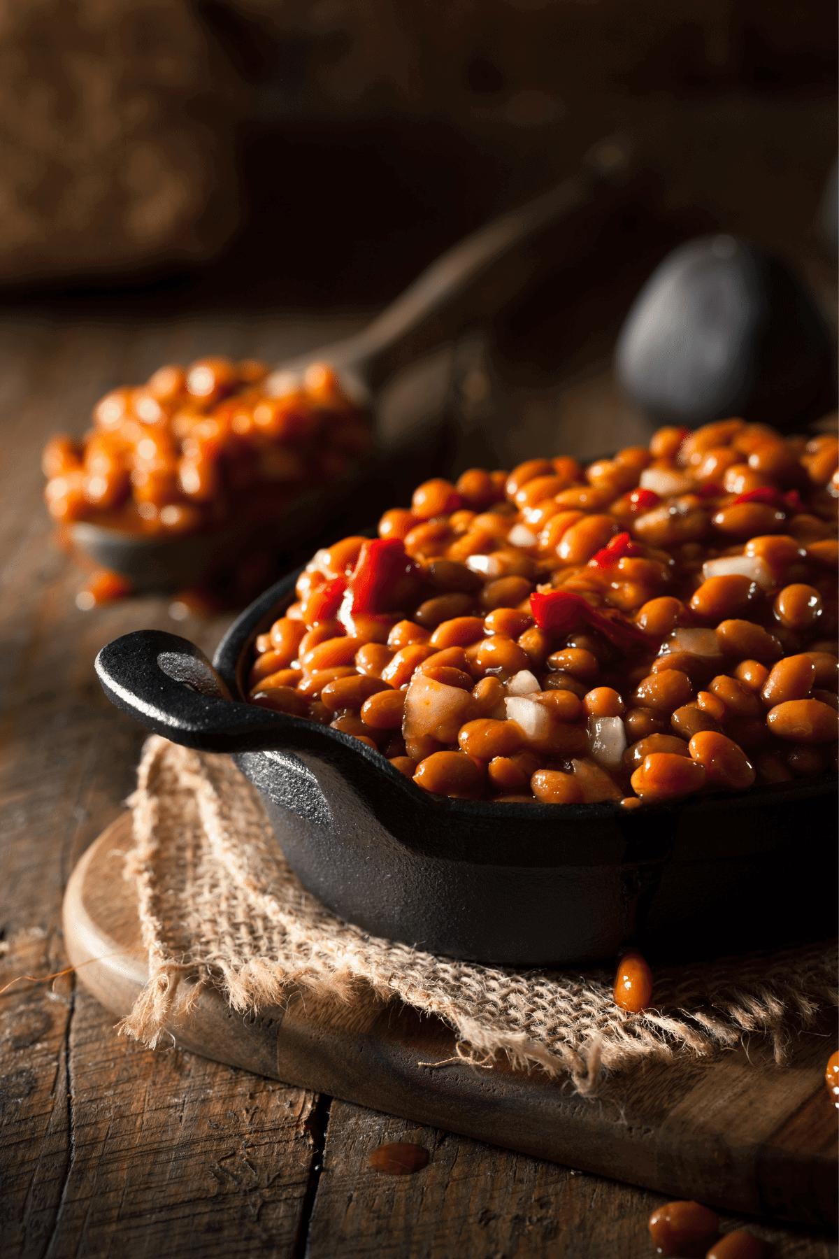 Baked beans fully cooked, dished up with a spoon