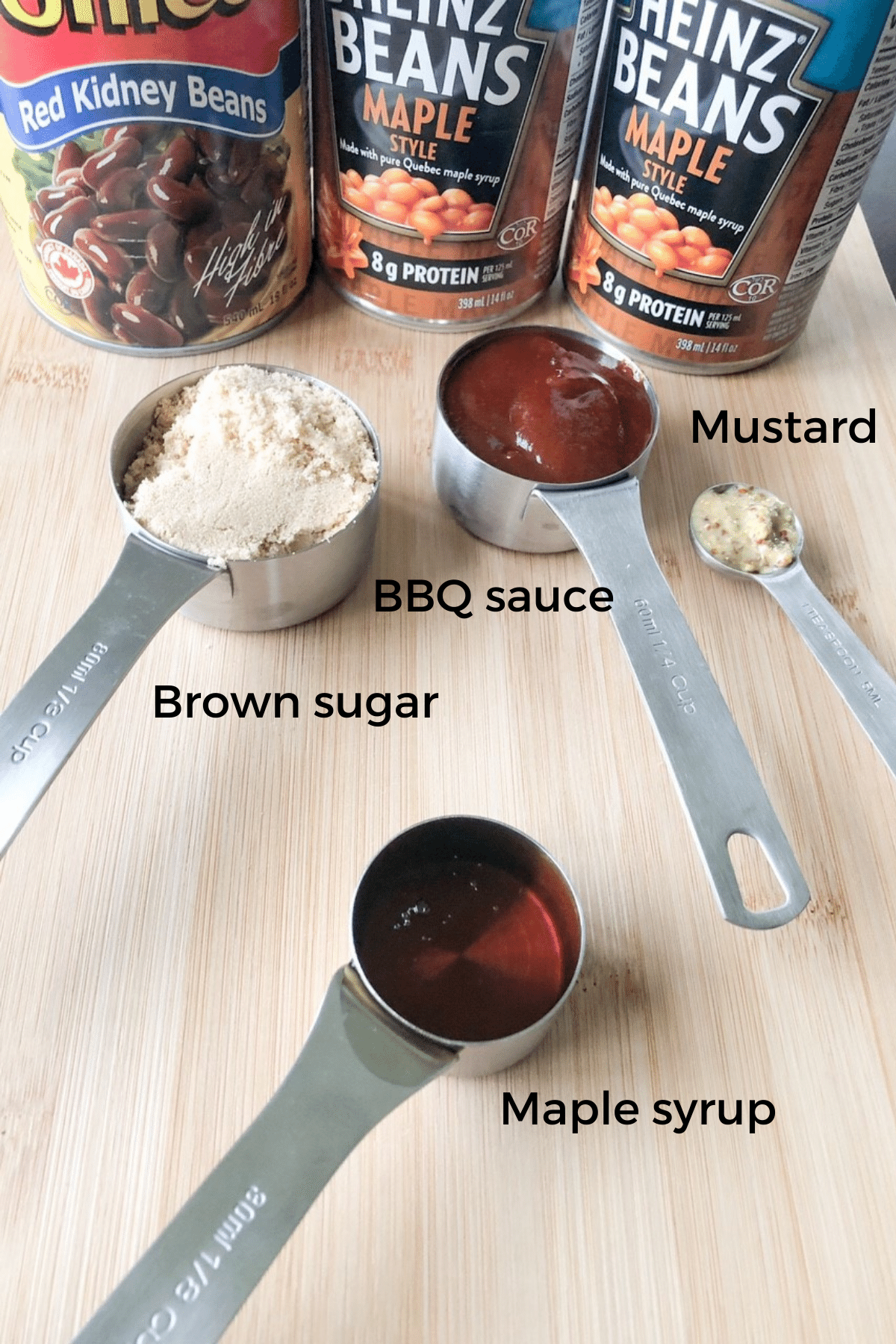 Ingredients needed to make baked beans, bbq sauce, brown sugar, mustard, and brown sugar