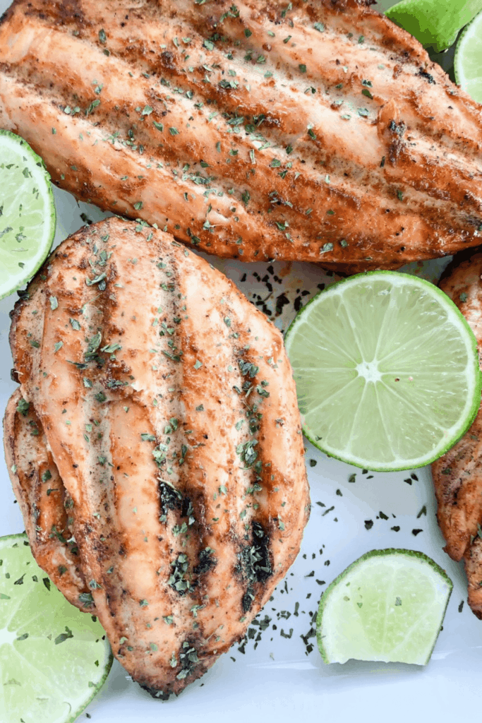 Cooked chicken breast served with lime