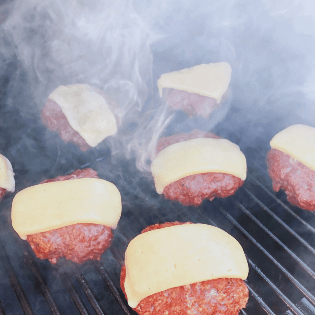 Smoked hamburgers on the pellet grill with cheese