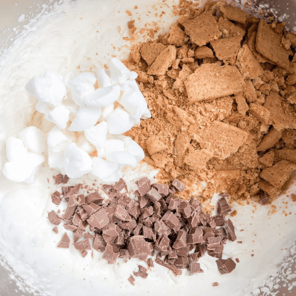 Add marshmallows, graham crackers, and chocolate to vanilla ice cream mixture