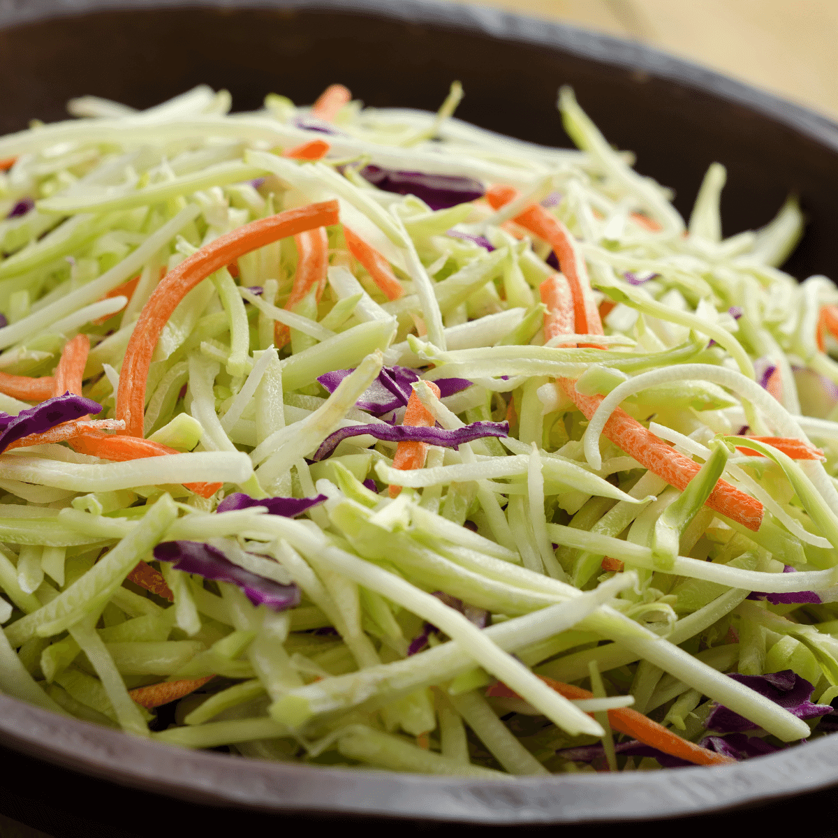 shredded cabbage and carrots in a bowl