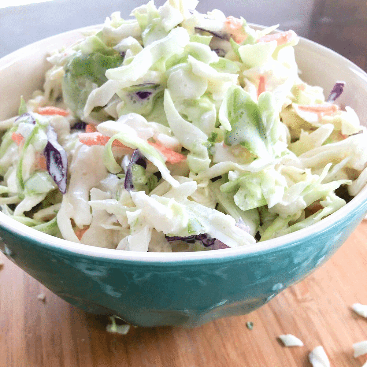 Creamy coleslaw in a blue bowl