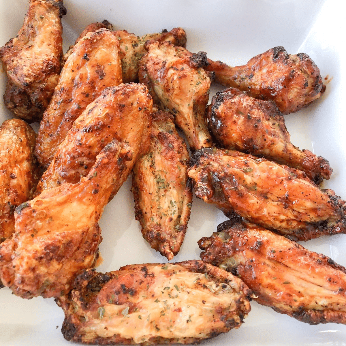 Extra crispy air fryer chicken wings served on a white platter