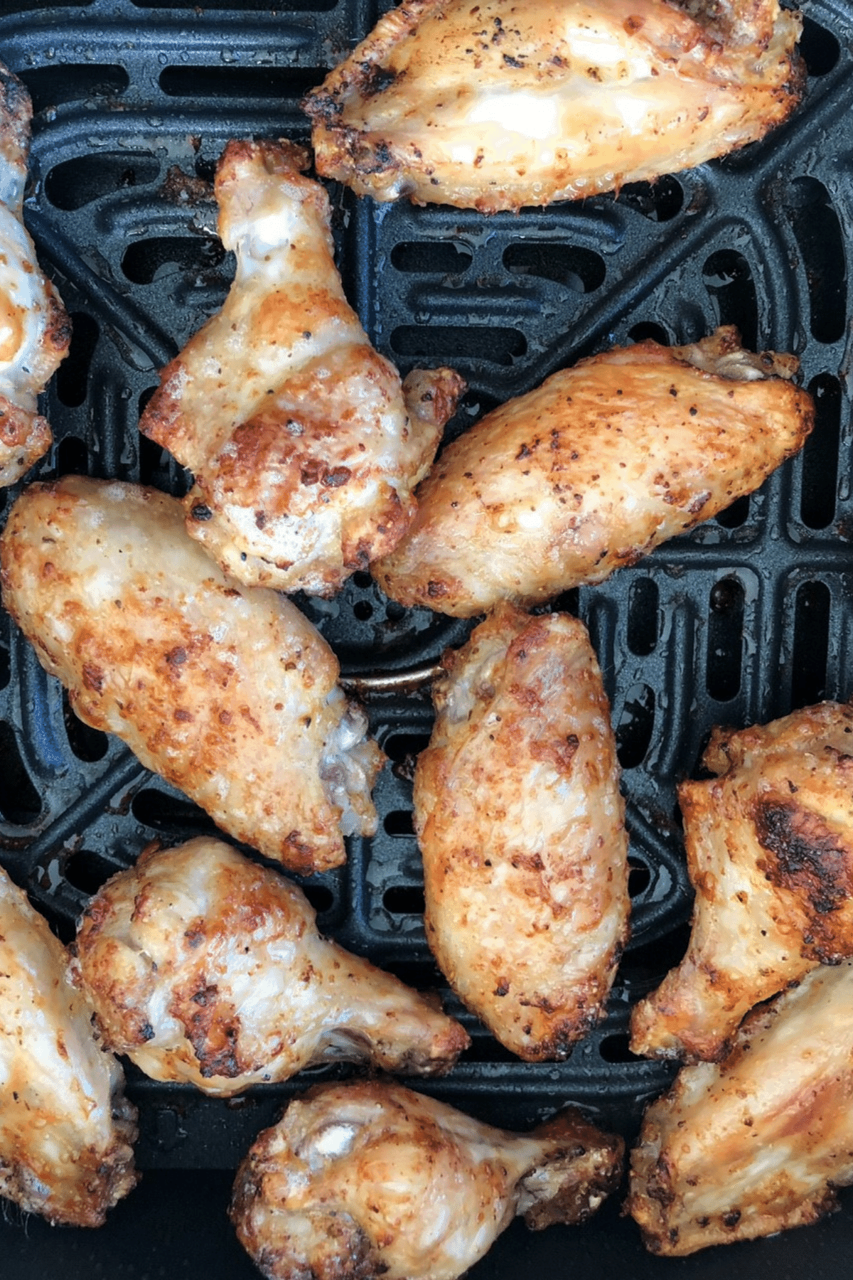 Air fryer wings after they are cooked for 25 minutes