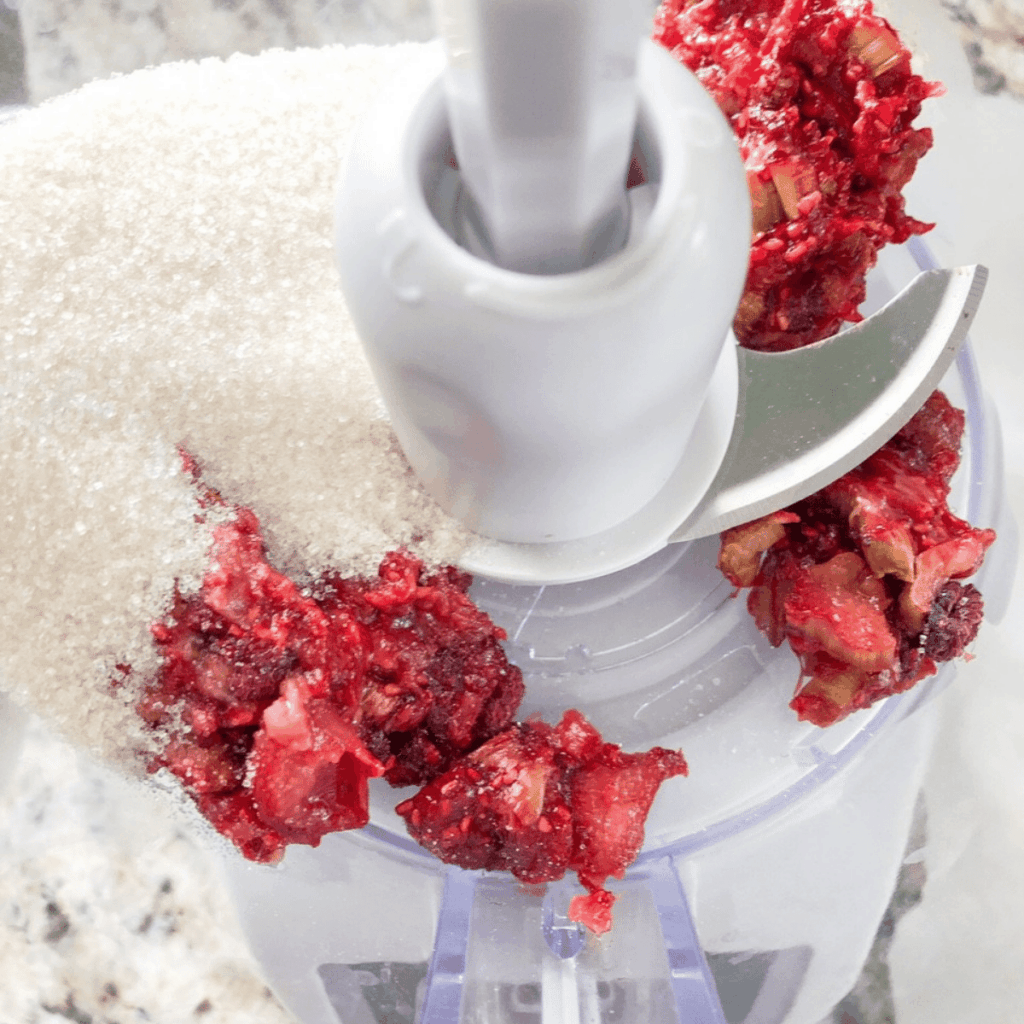 Cane sugar added to the rhubarb and raspberries in the food processor