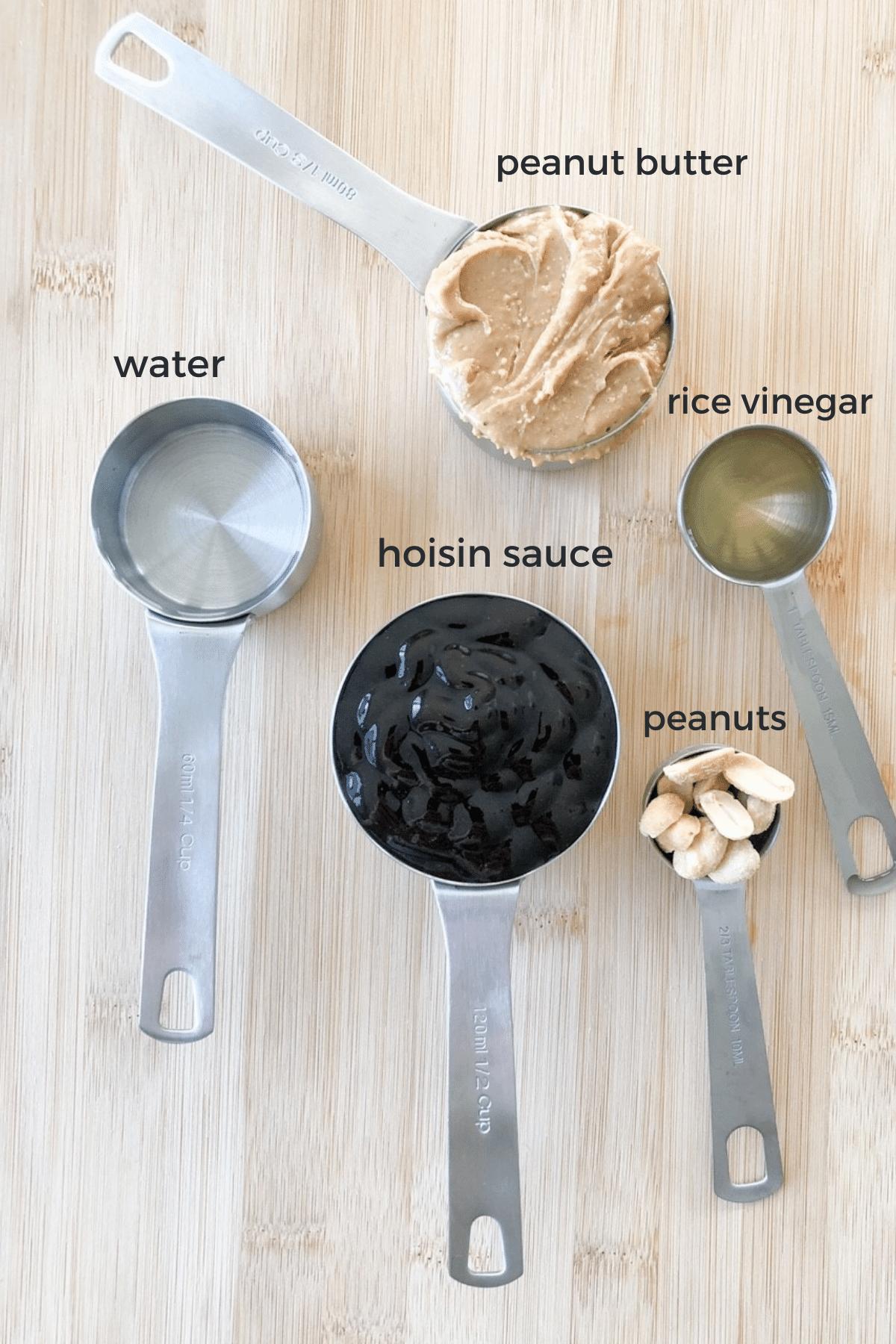 Ingredients needed to make hoisin-peanut sauce, peanut butter, hoisin sauce, water, rice vinegar, and peanuts