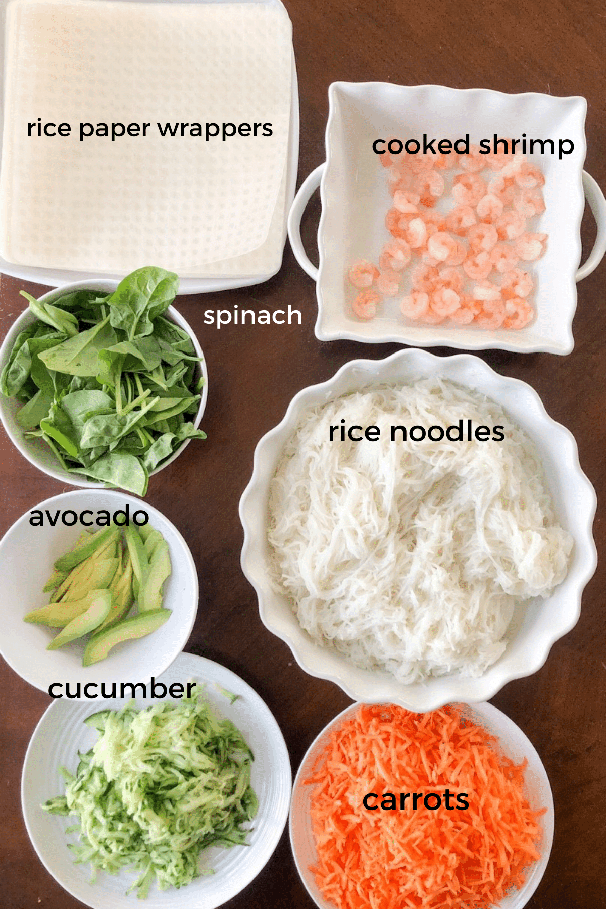 Ingredients for spring rolls placed in separate dishes, ready for rolling
