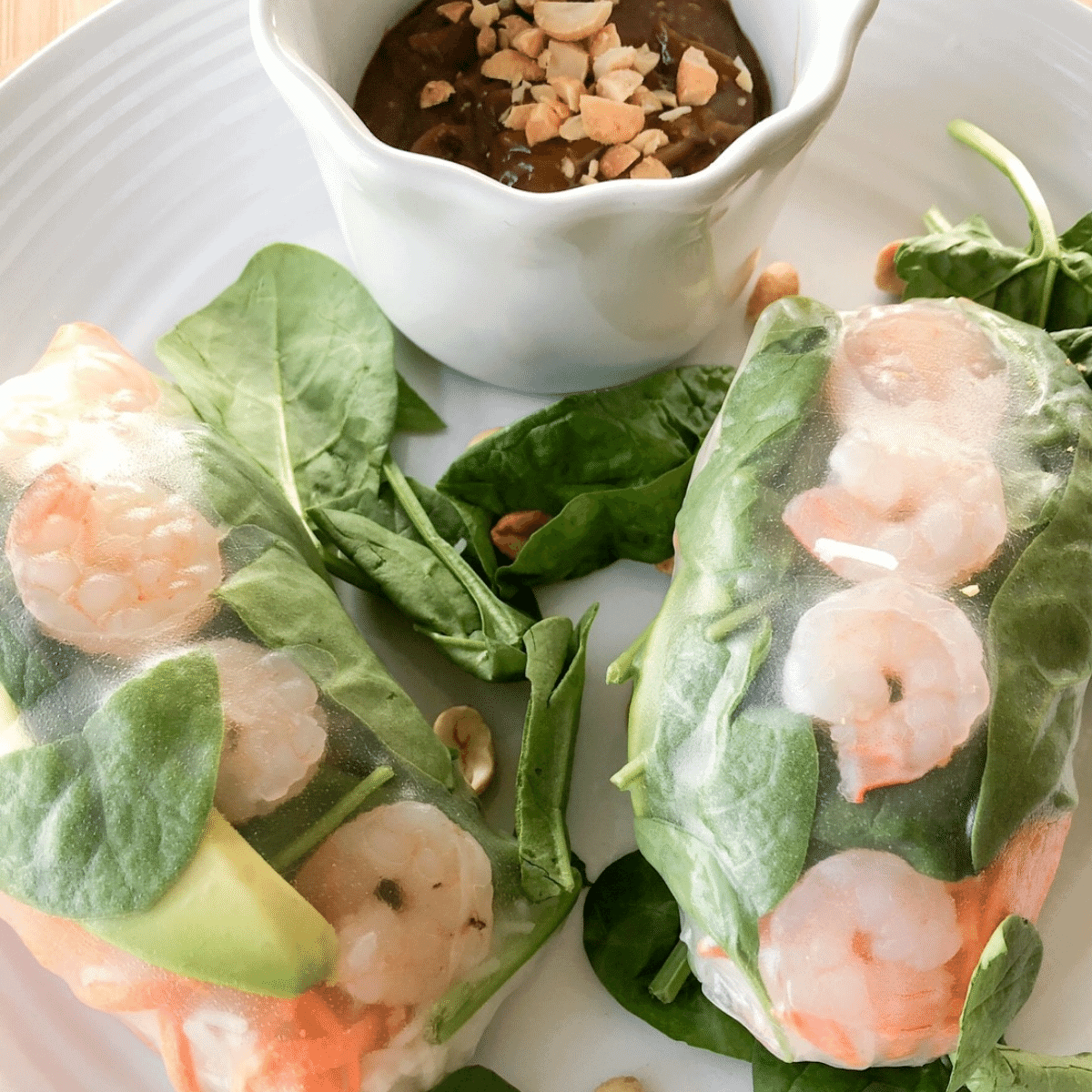 Salad rolls served with peanut dipping sauce