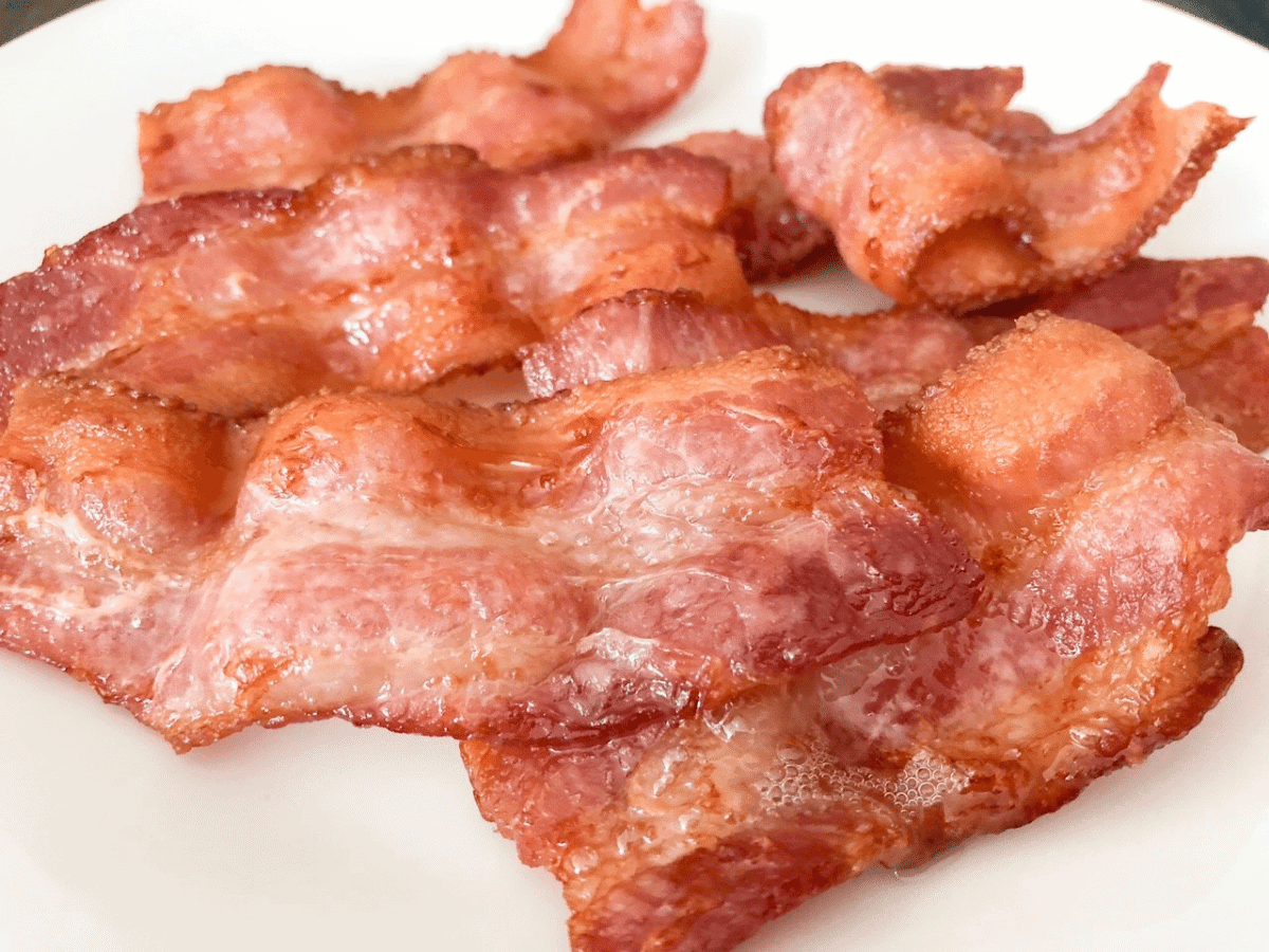 Perfectly cooked bacon in the air fryer, tender and crispy