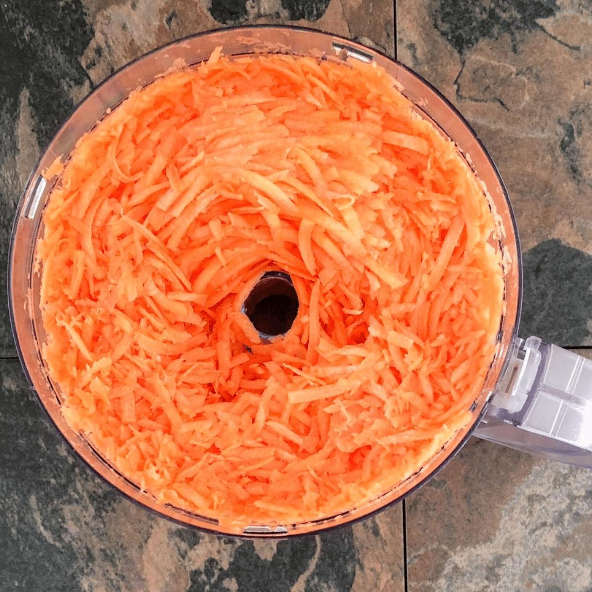 Freshly shredded carrots in the food processor
