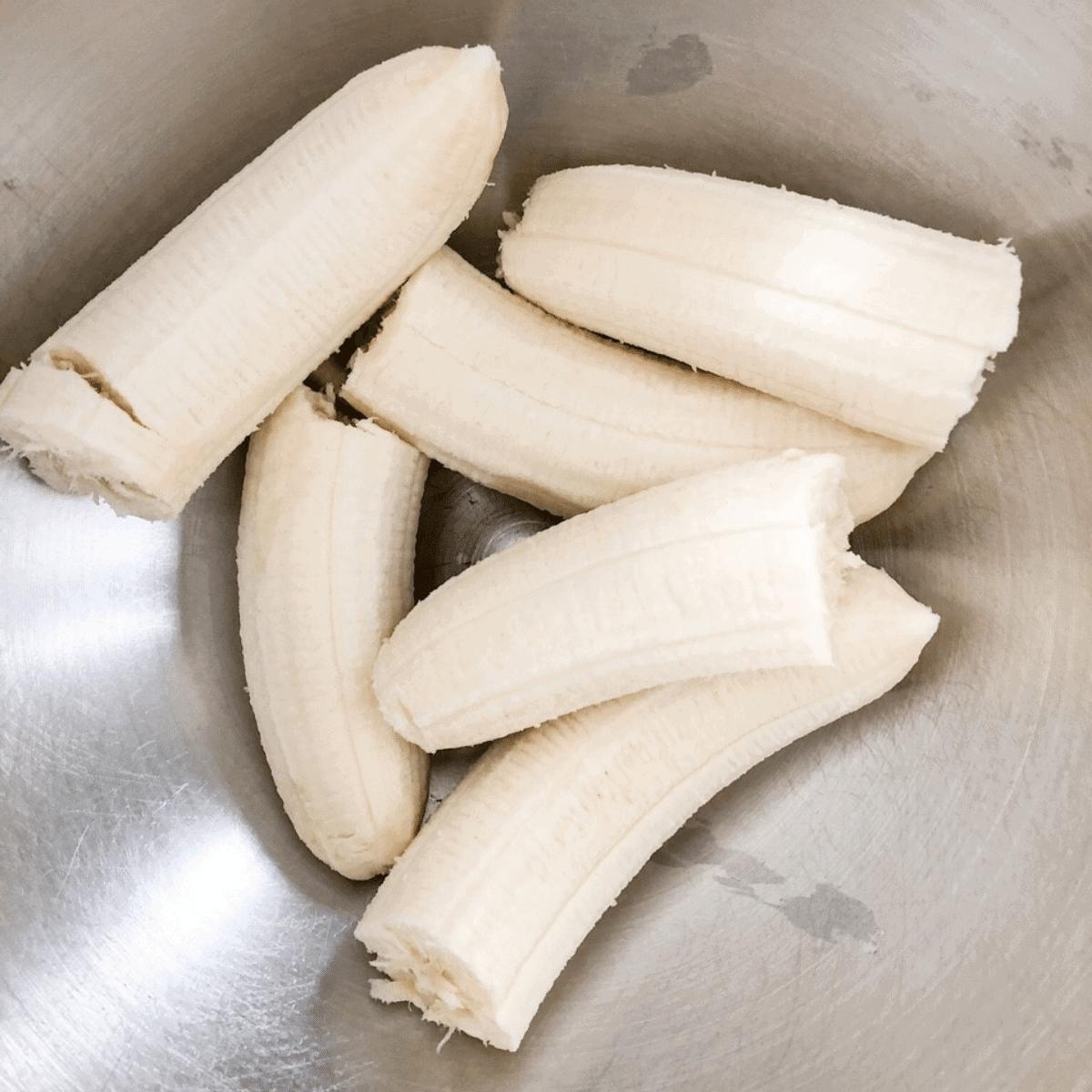 Peeled ripe bananas in mixing bowl