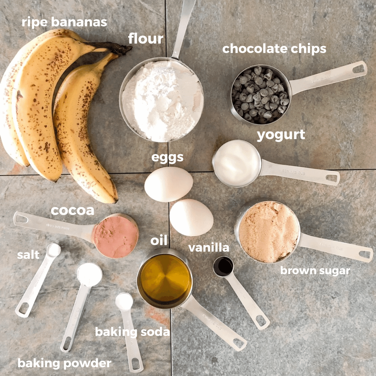 Ingredients for the banana chocolate chip muffins laid out in measuring cups and spoons