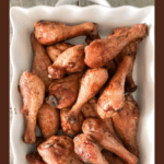 Long pin for Smoked chicken drumsticks served on a white platter