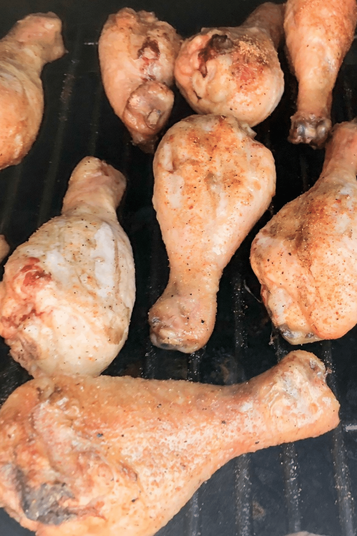 Smoked chicken drumsticks smoking on the Pit Boss Pellet grill