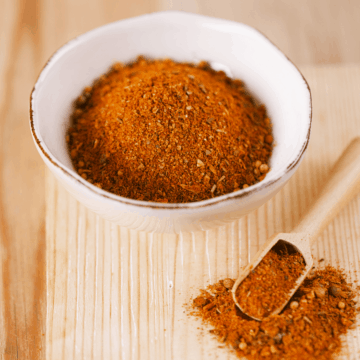 Dry spice rub for chicken in a white bowl