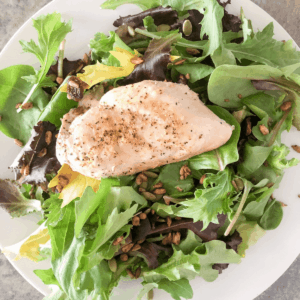 Instant pot chicken breast lightly seasoned and placed on a bed of lettuce