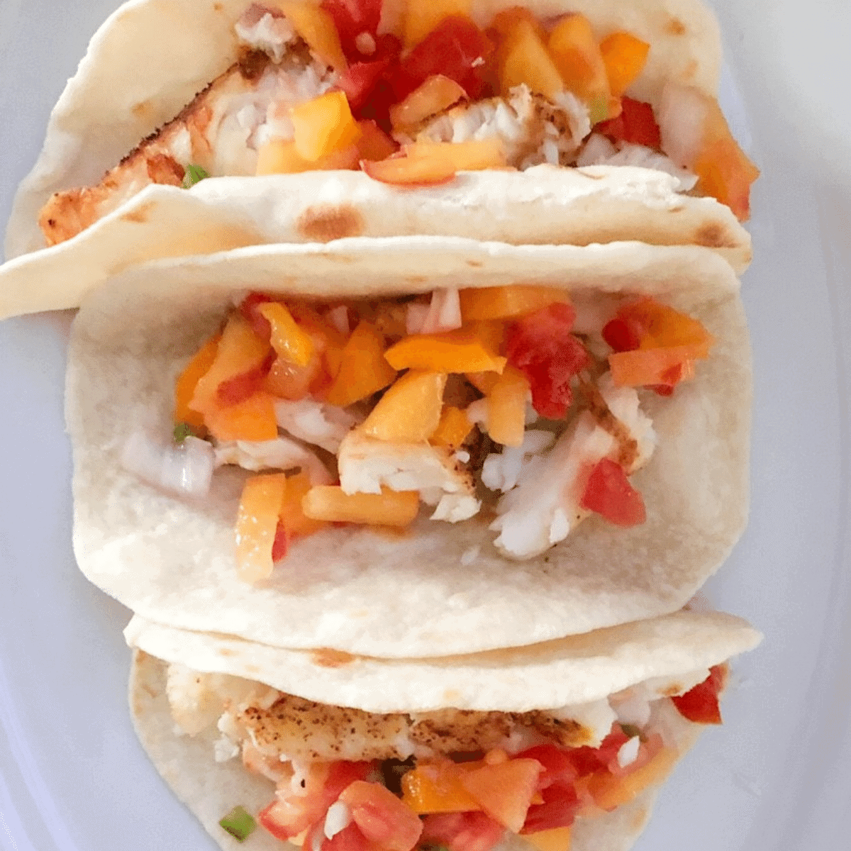 3 ingredient flatbread used for fish tacos with tilapia and peach pico de gallo