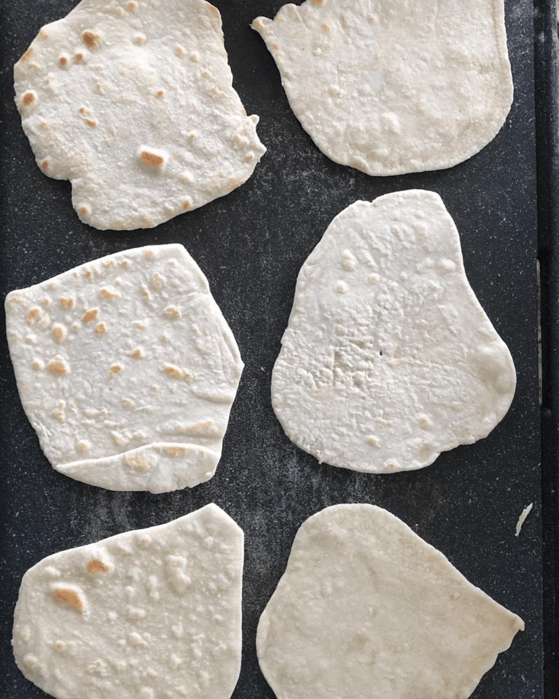 Cook the flatbread dough on a skillet or griddle over medium heat until brown spots begin to form