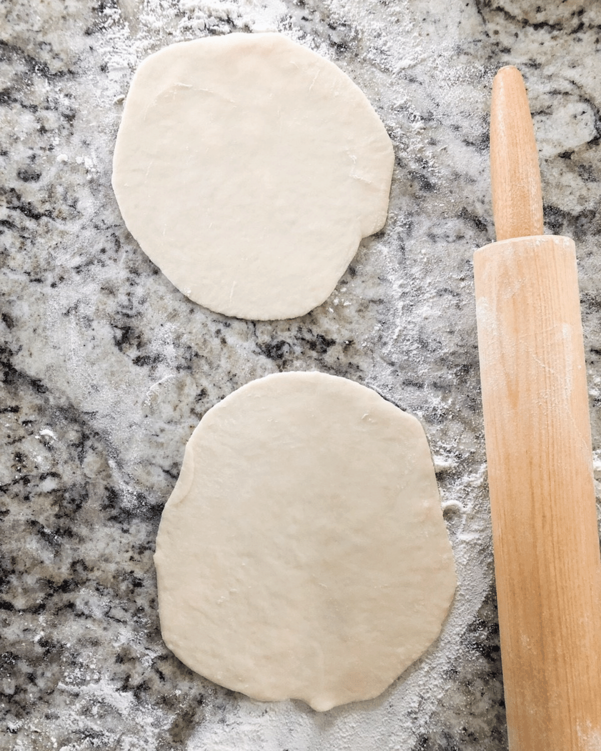 Roll out flatbread dough with rolling pin until desired size